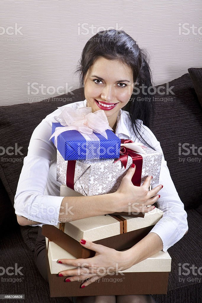 girl holds boxes of gifts stock photo