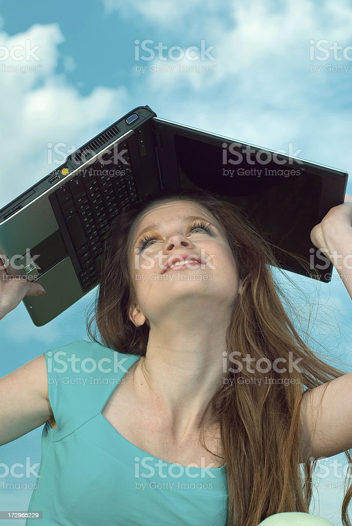 girl holds computer above a head royalty-free stock photo