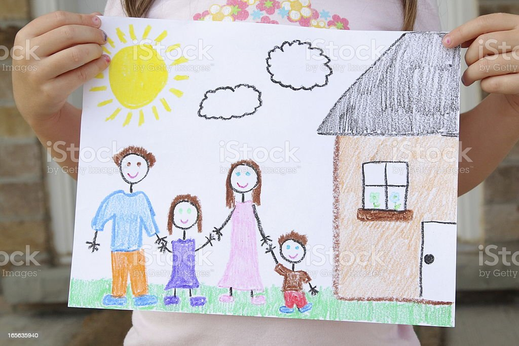 Girl Holds Drawing of Her Family stock photo