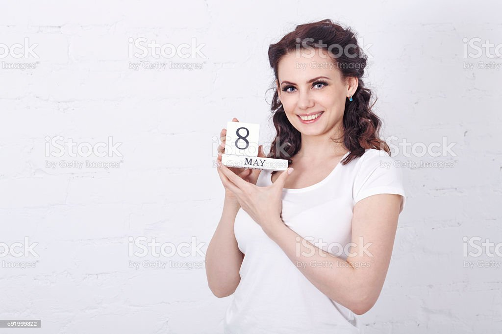 Girl holds sign March 8. stock photo
