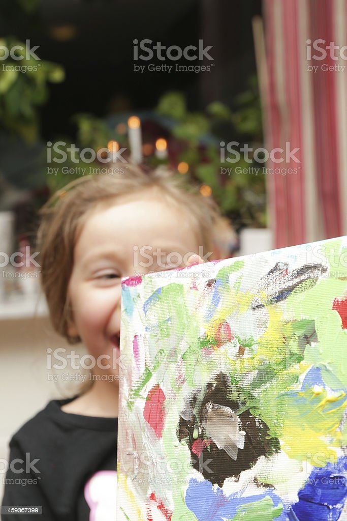 Girl holing up a canvas painting stock photo