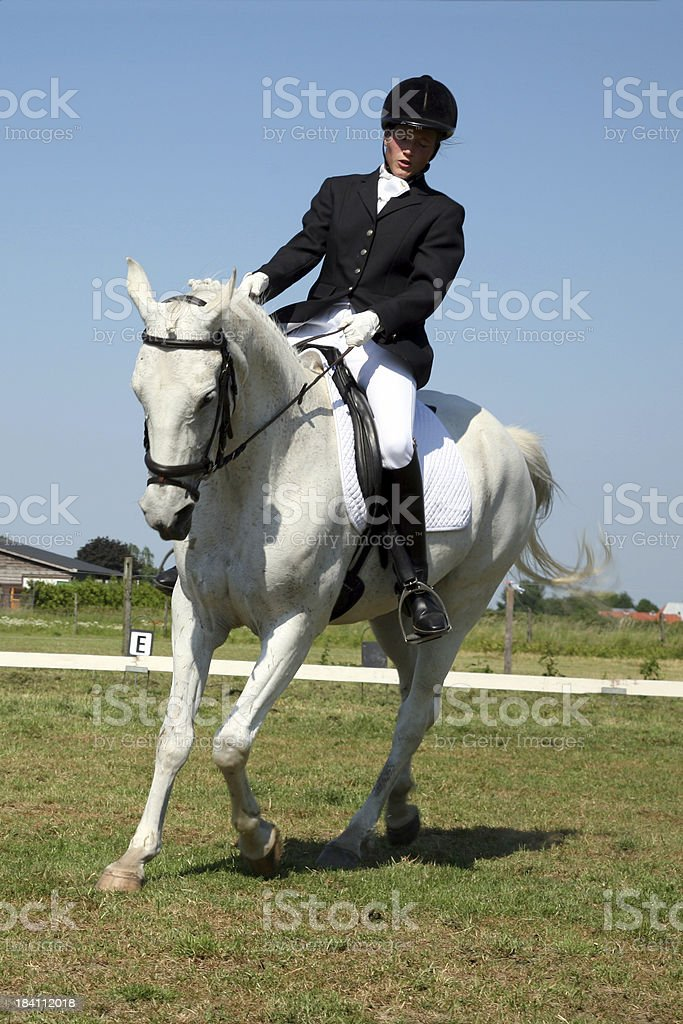 Girl horseback riding 5 stock photo