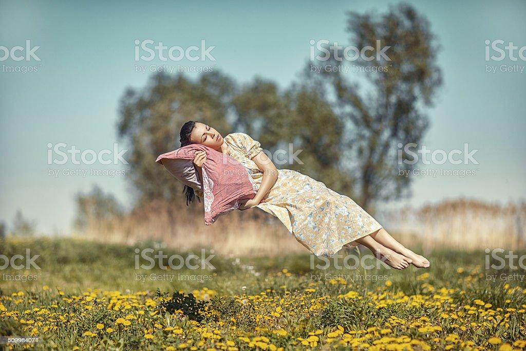 Girl hovers and sleeps. stock photo