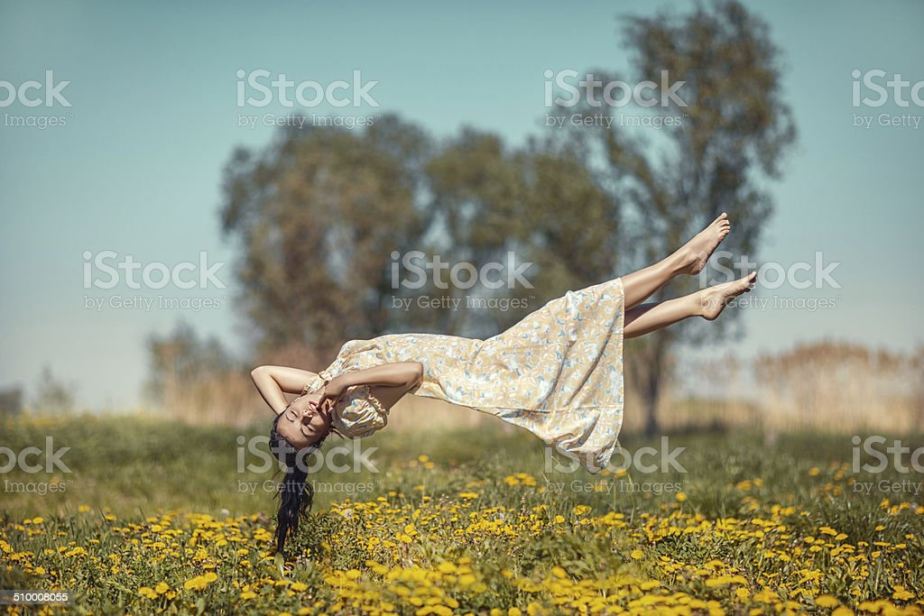 Girl hovers over the field. stock photo