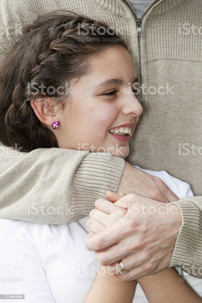 Girl hugged by dad stock photo