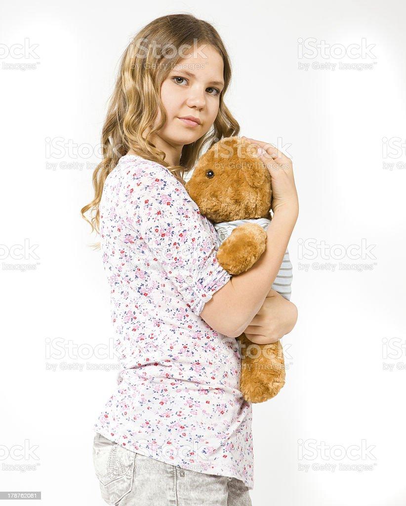 Girl hugging a teddy bear royalty-free stock photo