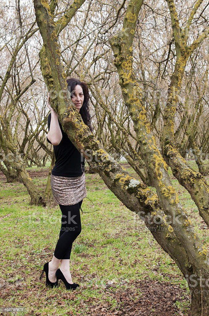 Girl hugging a tree royalty-free stock photo