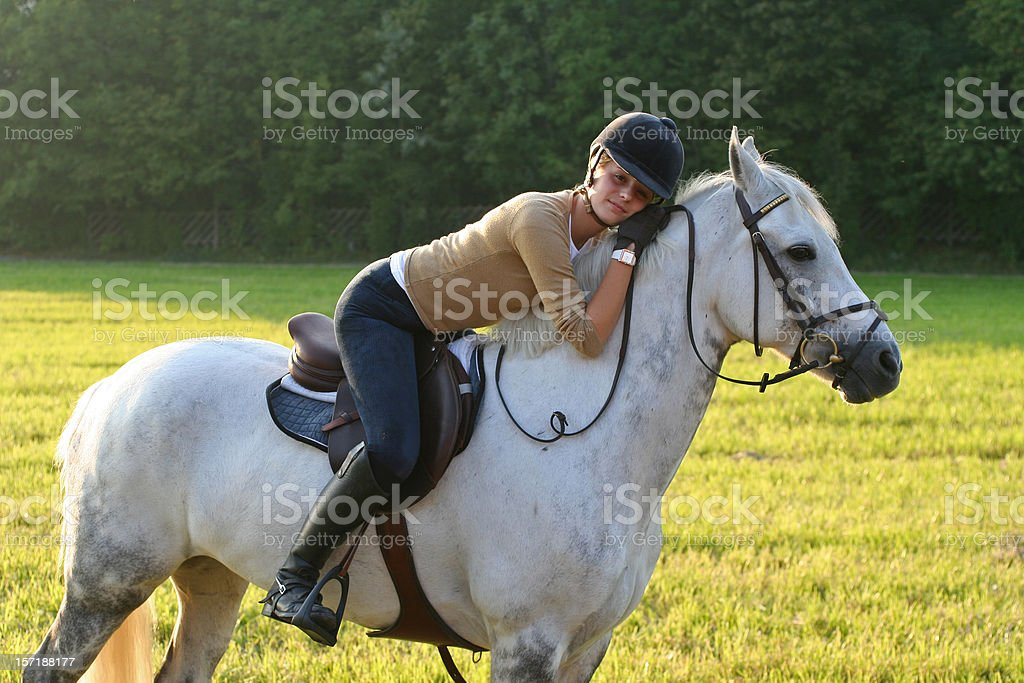 Girl hugging a white horse royalty-free stock photo