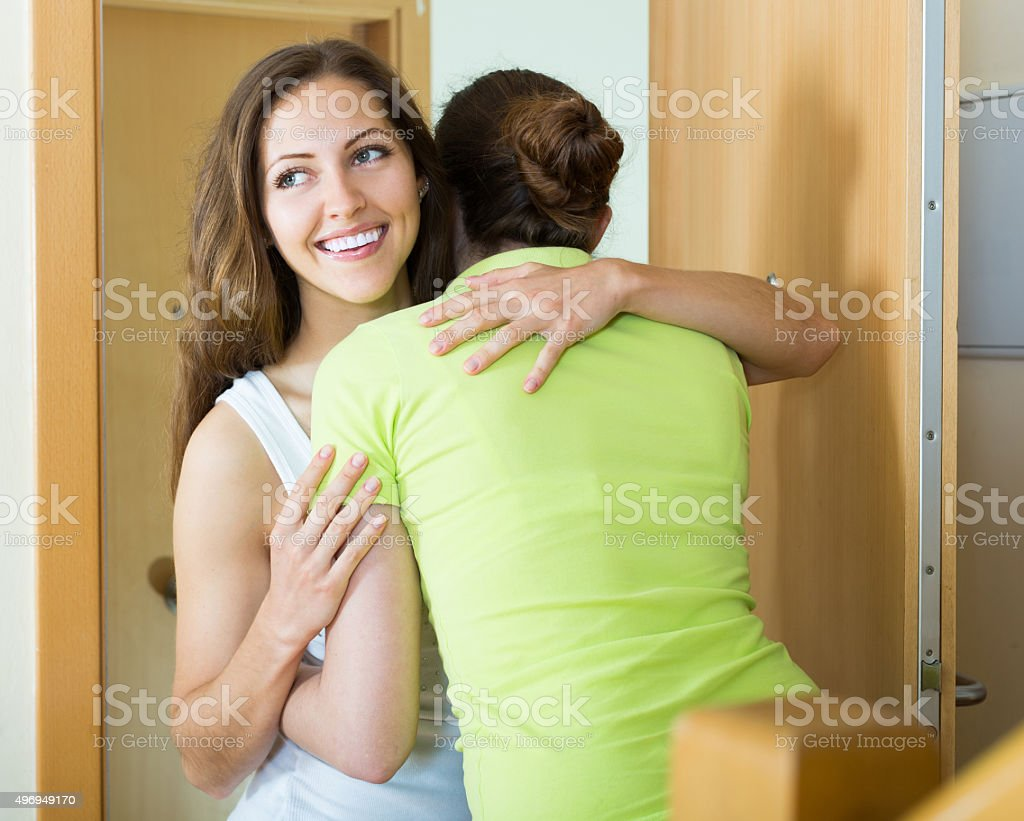 Girl hugging girlfriend stock photo