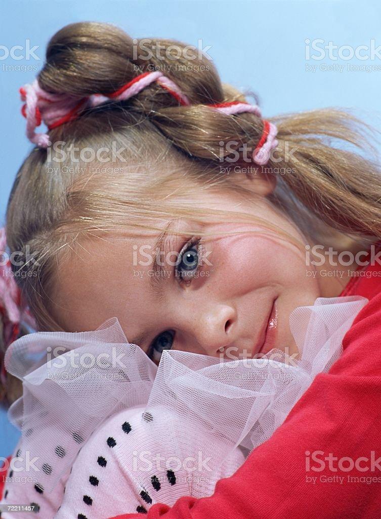 Girl hugging her knees royalty-free stock photo
