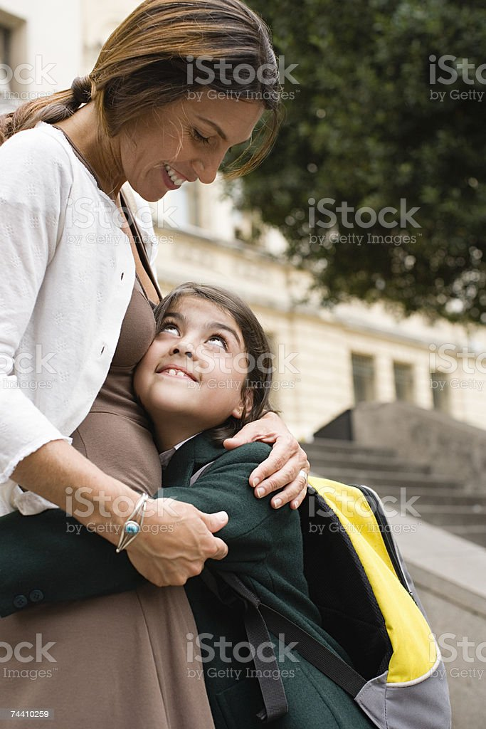 Girl hugging her mother royalty-free stock photo
