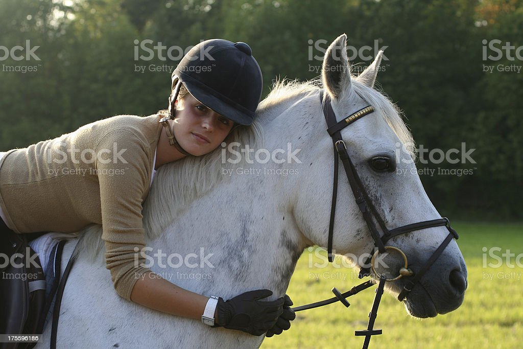 Girl Hugging Horse royalty-free stock photo