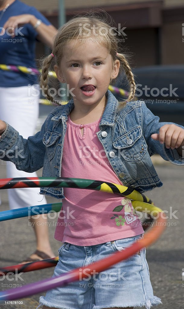 Girl Hula Hooping royalty-free stock photo