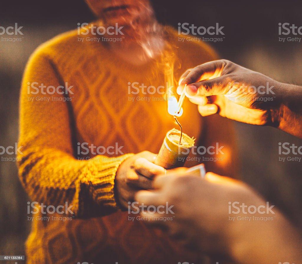 Girl igniting smoke bomb stock photo