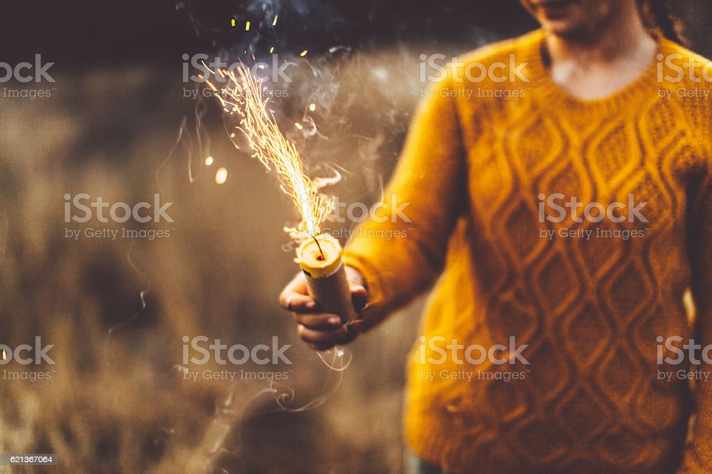 Girl igniting smoke bomb stock photo