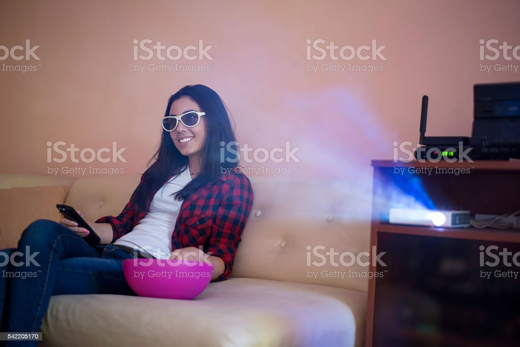 Girl in 3D glasses at home stock photo
