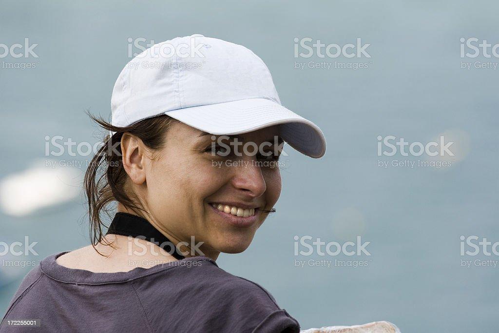 Girl in a baseball cap stock photo