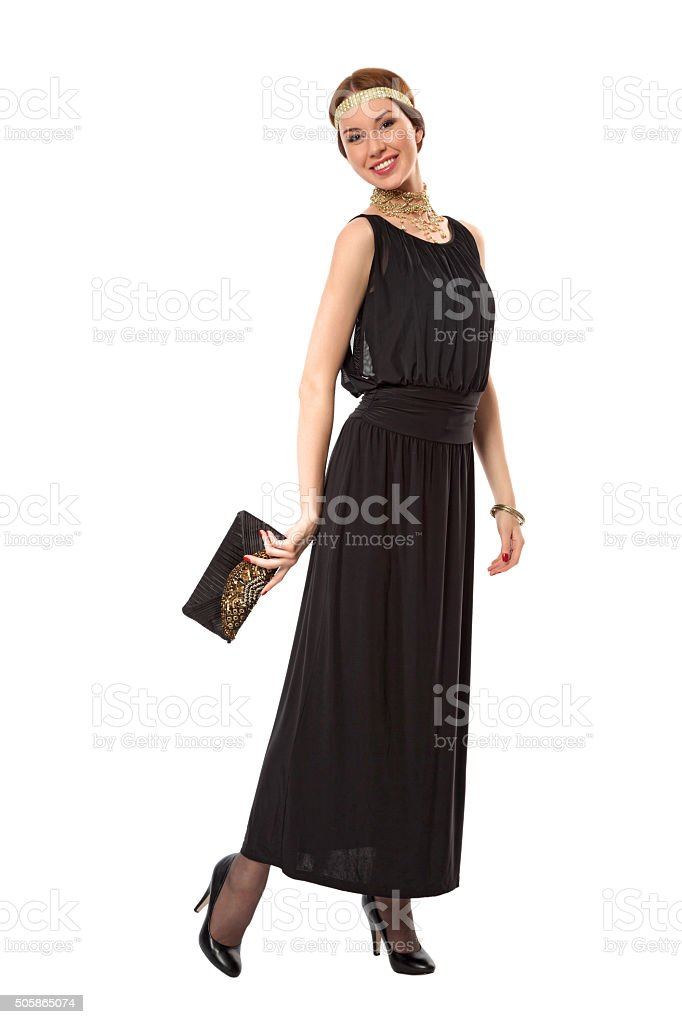 Girl in a black retro dress stock photo