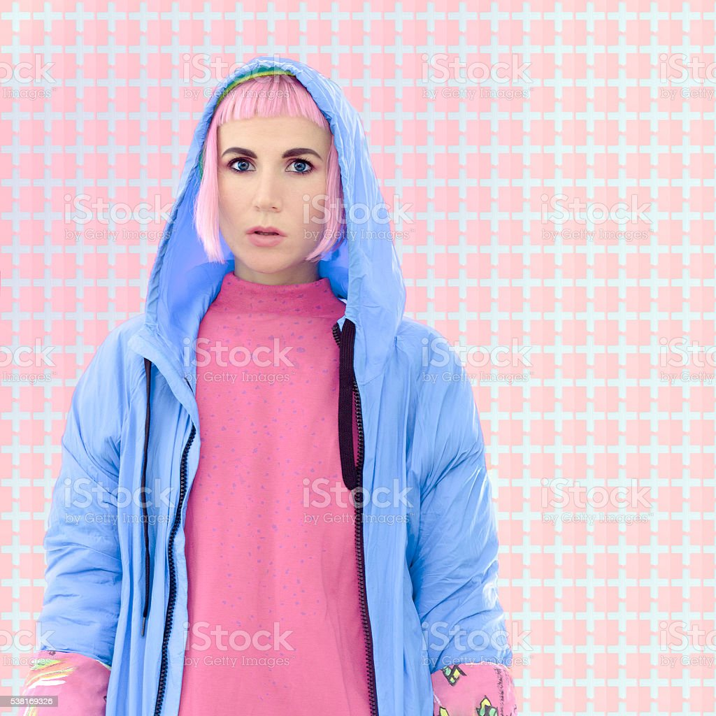 Girl in a blue coat fashion. Vanilla pastel colors stock photo