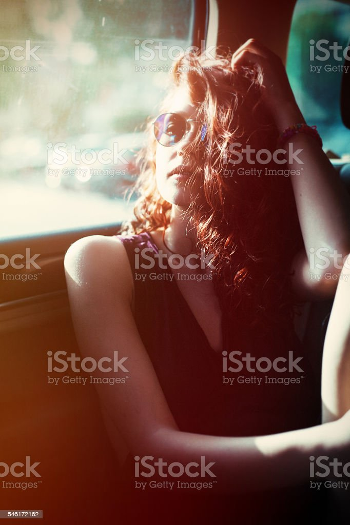 Girl in a car stock photo