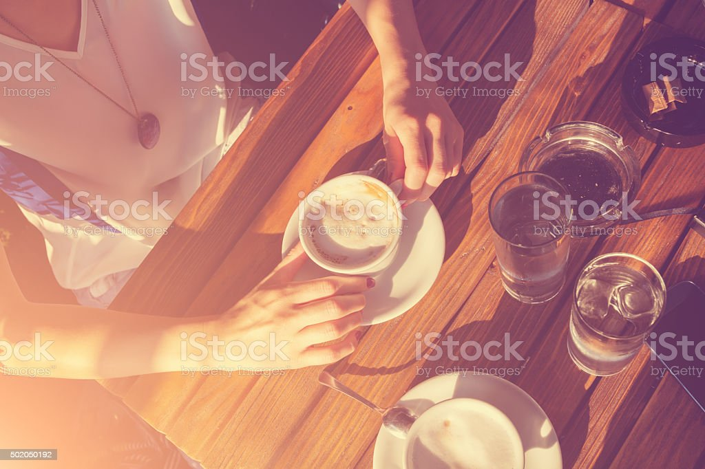Girl in a coffee shop. stock photo