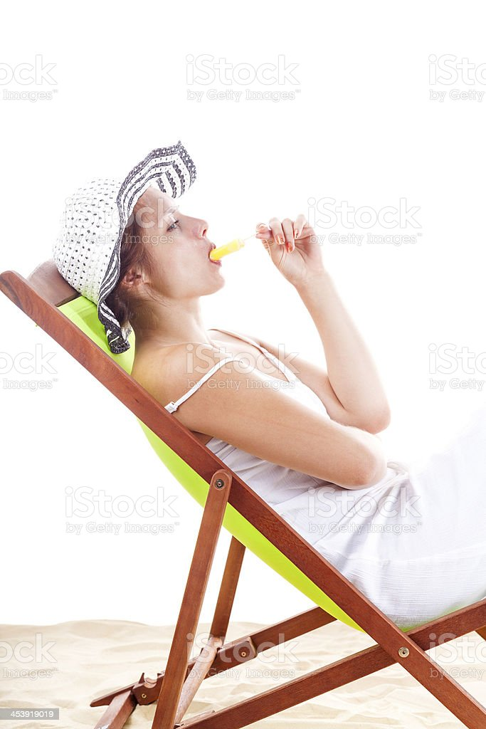 Girl In A Deckchair Sucking Her Ice Lolly royalty-free stock photo