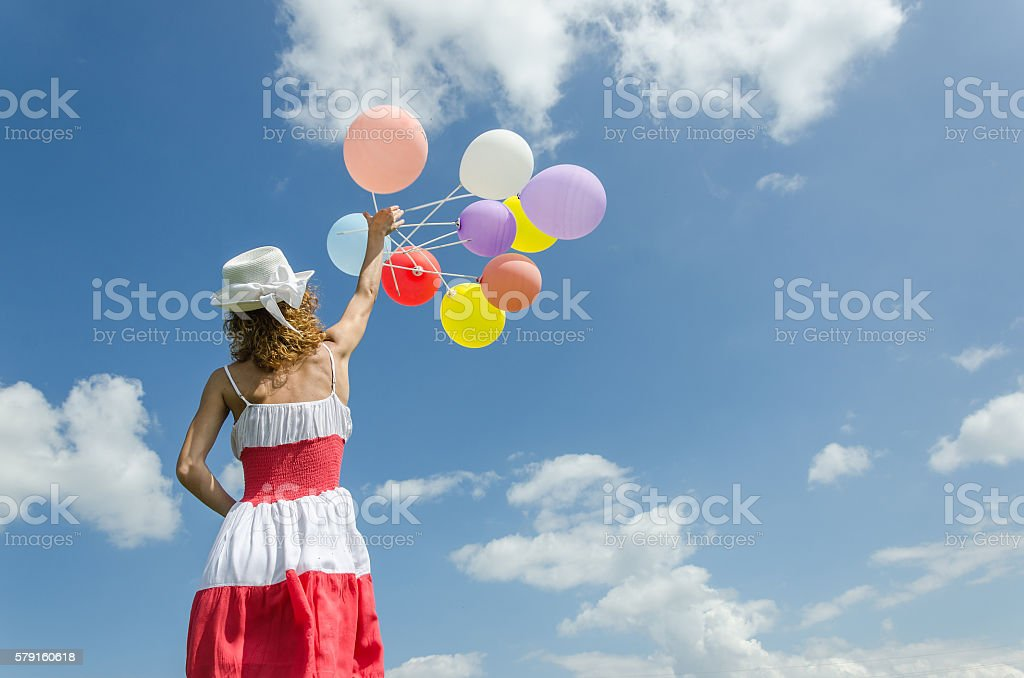girl in a dress standing with her back stock photo