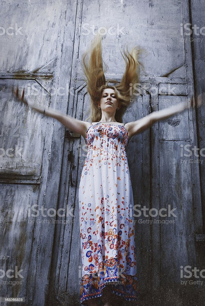 Girl in a dress with flying hair royalty-free stock photo
