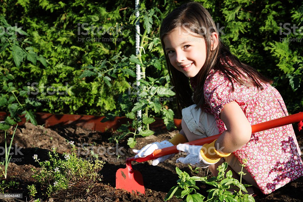 Girl in a garden royalty-free stock photo