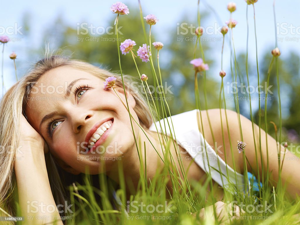 Girl in a grass (medium format image) stock photo