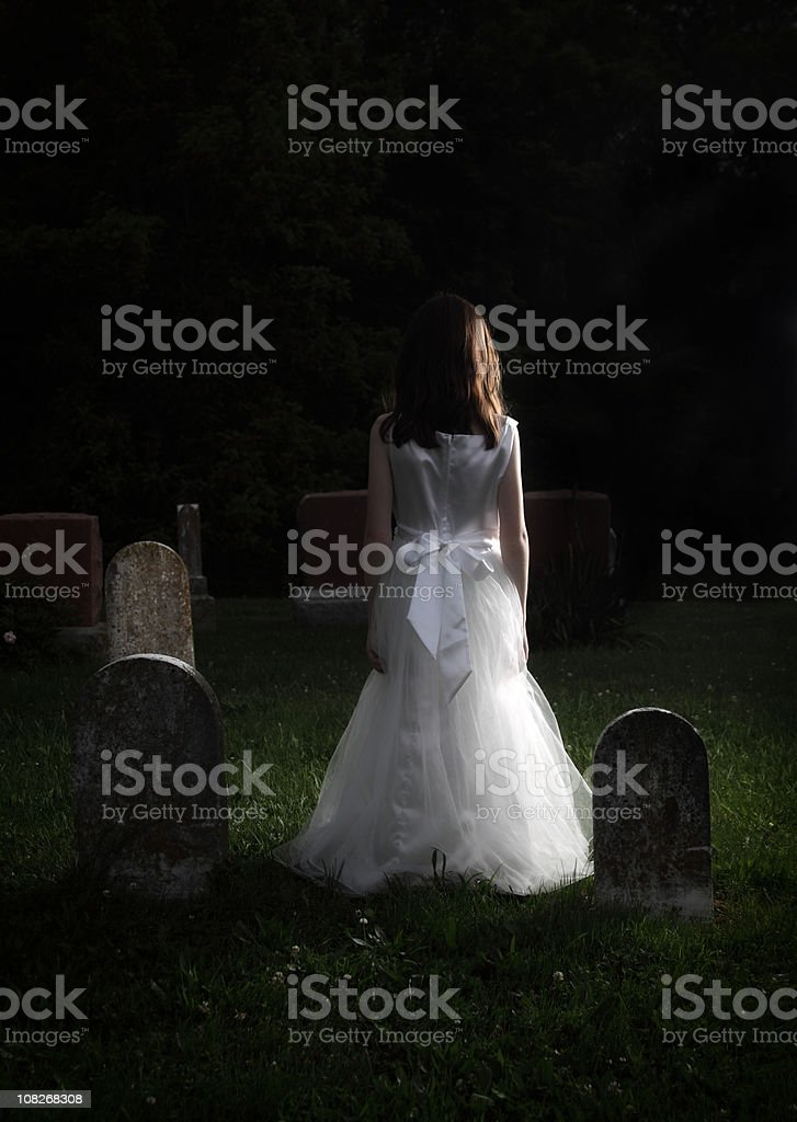 Girl in a Graveyard royalty-free stock photo