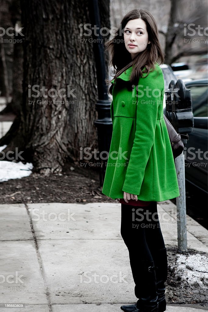 Girl in a green coat royalty-free stock photo