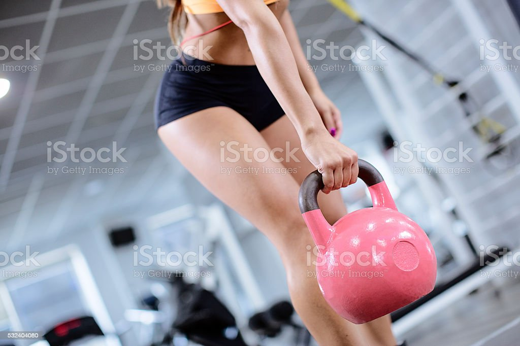 girl in a gym weight lifted stock photo