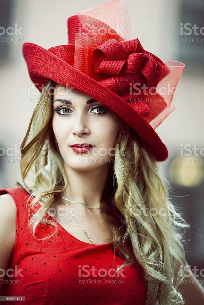Girl in a hat red retro stock photo