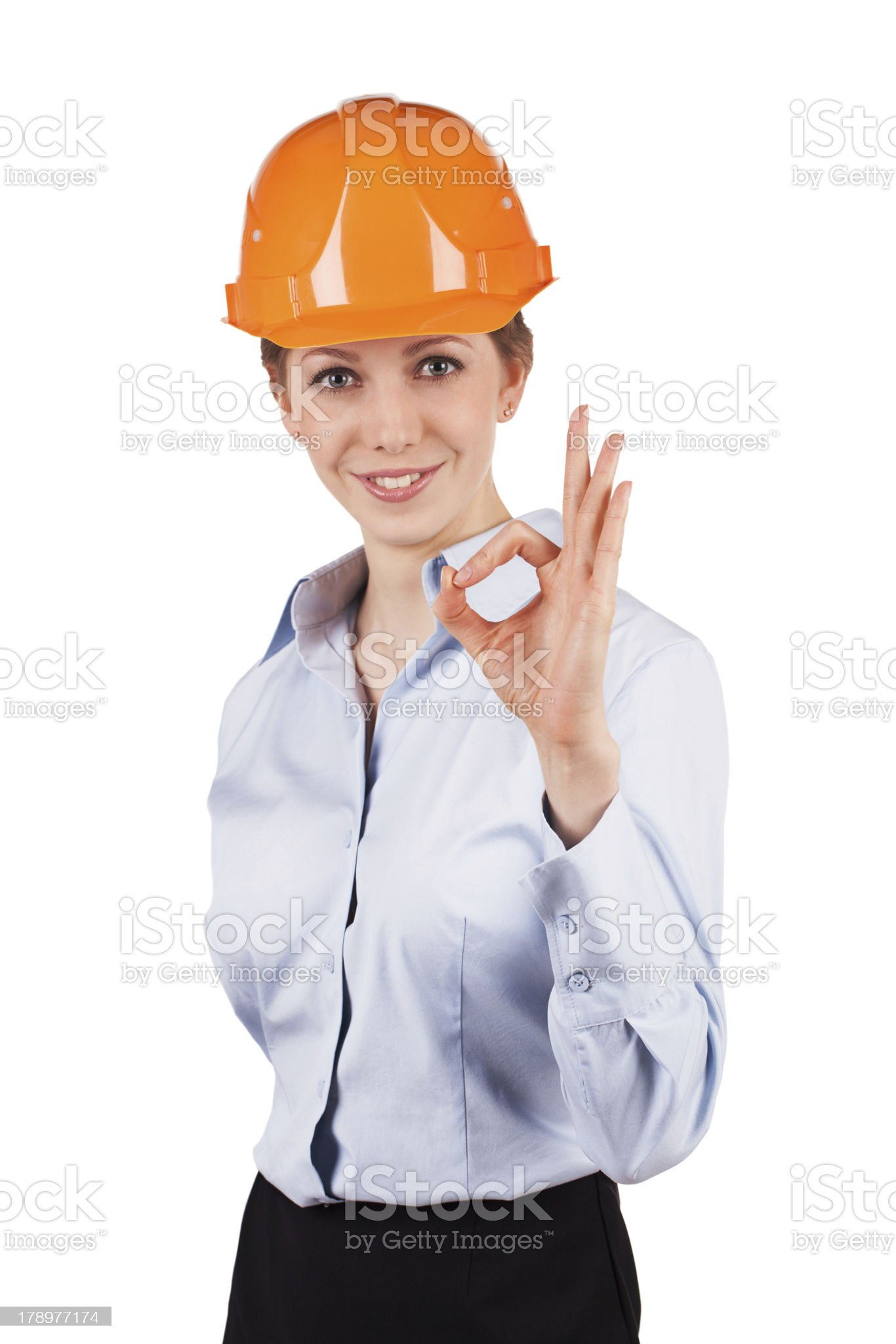 Girl in a helmet shows that all okay royalty-free stock photo