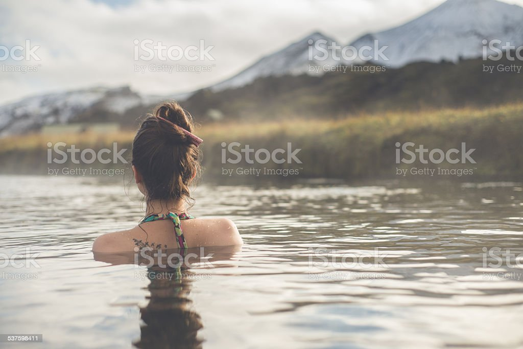 Girl in a hot spring in Iceland Landmannalaugar stock photo