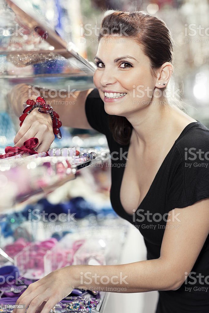 girl in a  jewelry shop stock photo
