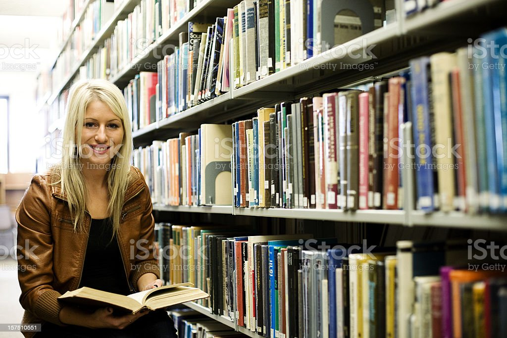 Girl in a library royalty-free stock photo