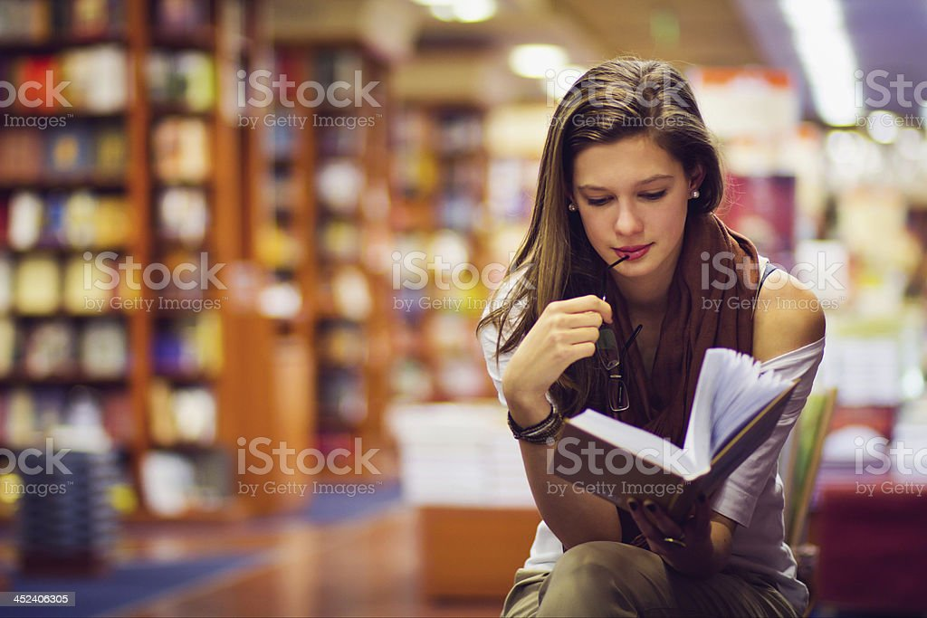 girl in a library stock photo