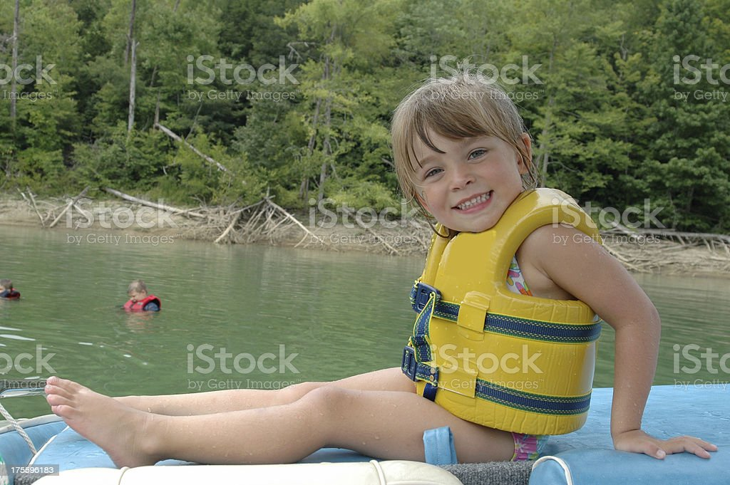 girl in a life jacket stock photo