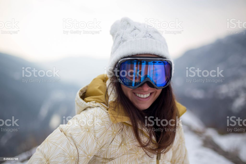 girl in a mask for snowboarding stock photo