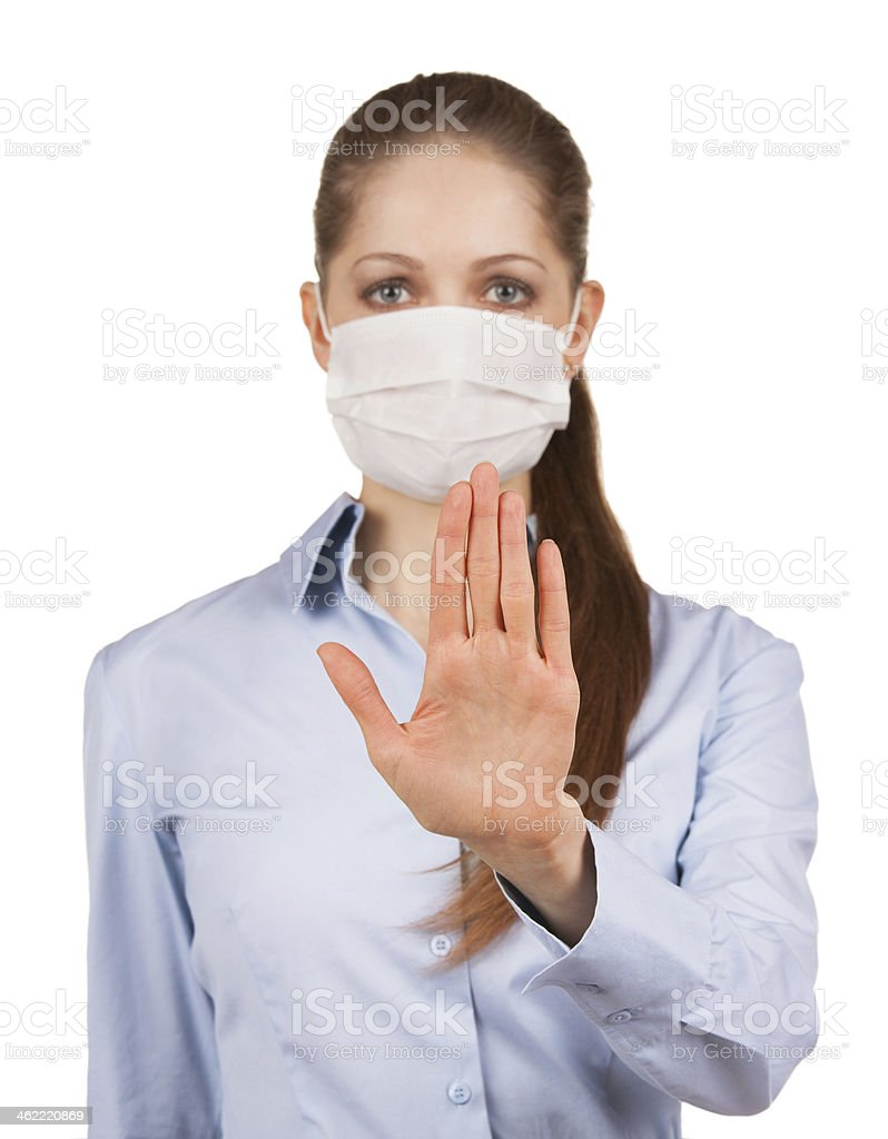 Girl in a mask held out his hand stock photo