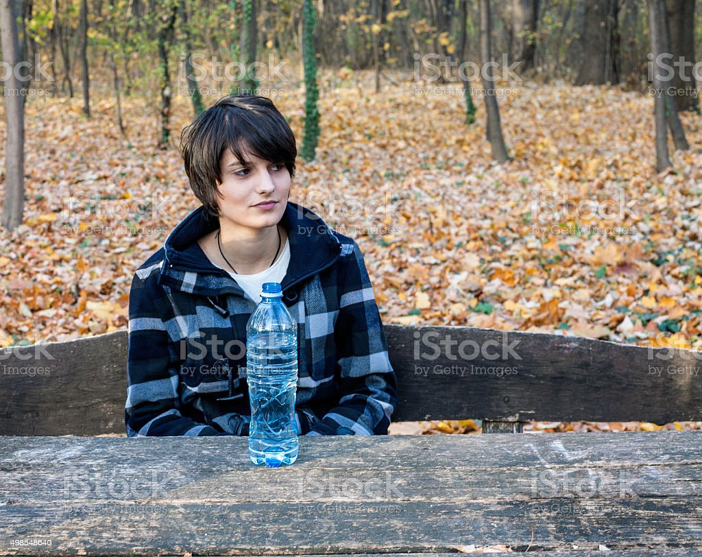 Girl in a park with a water bottle royalty-free stock photo