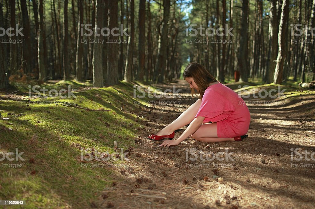 Girl in a pine forest stock photo