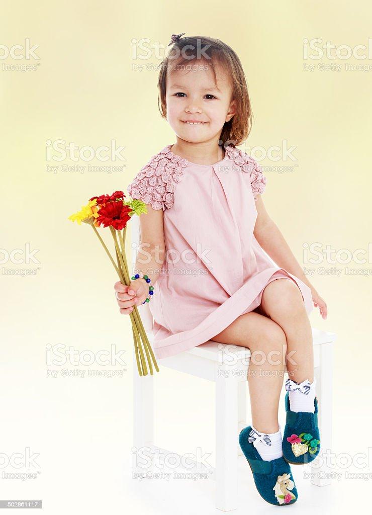 Fille dans une robe rose photo libre de droits