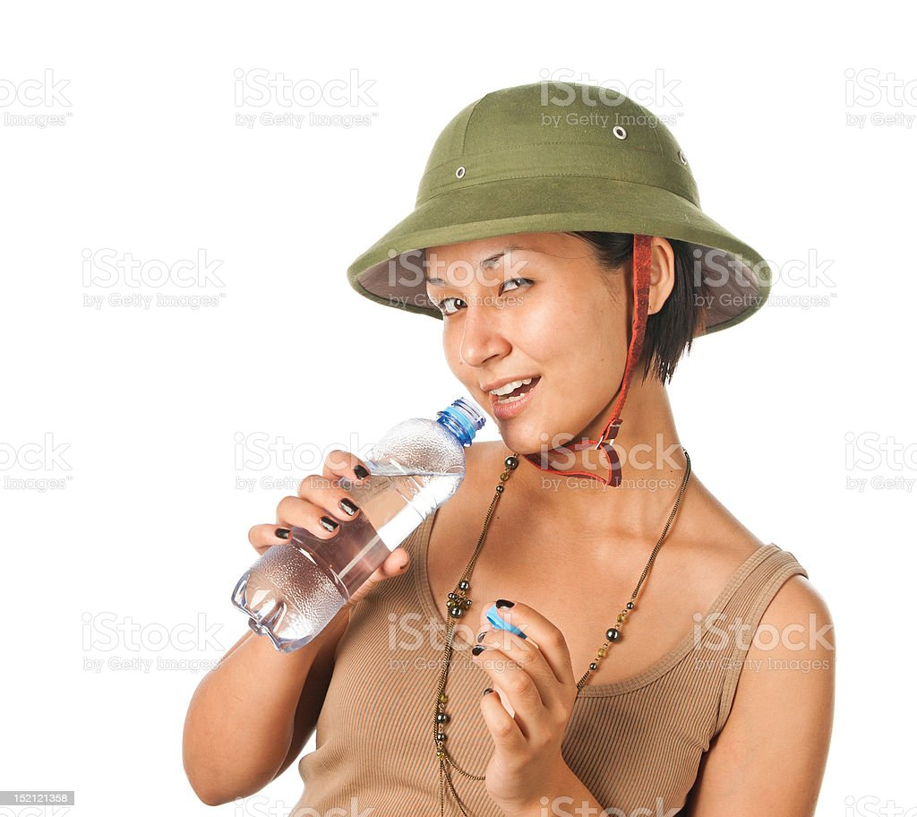 Girl in a pith helmet with bottle of water stock photo