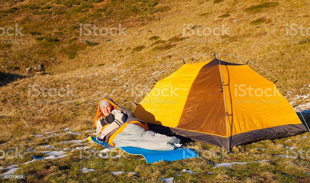 Girl in a sleeping bag. stock photo