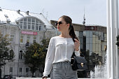 Girl in a smart clothes in city
