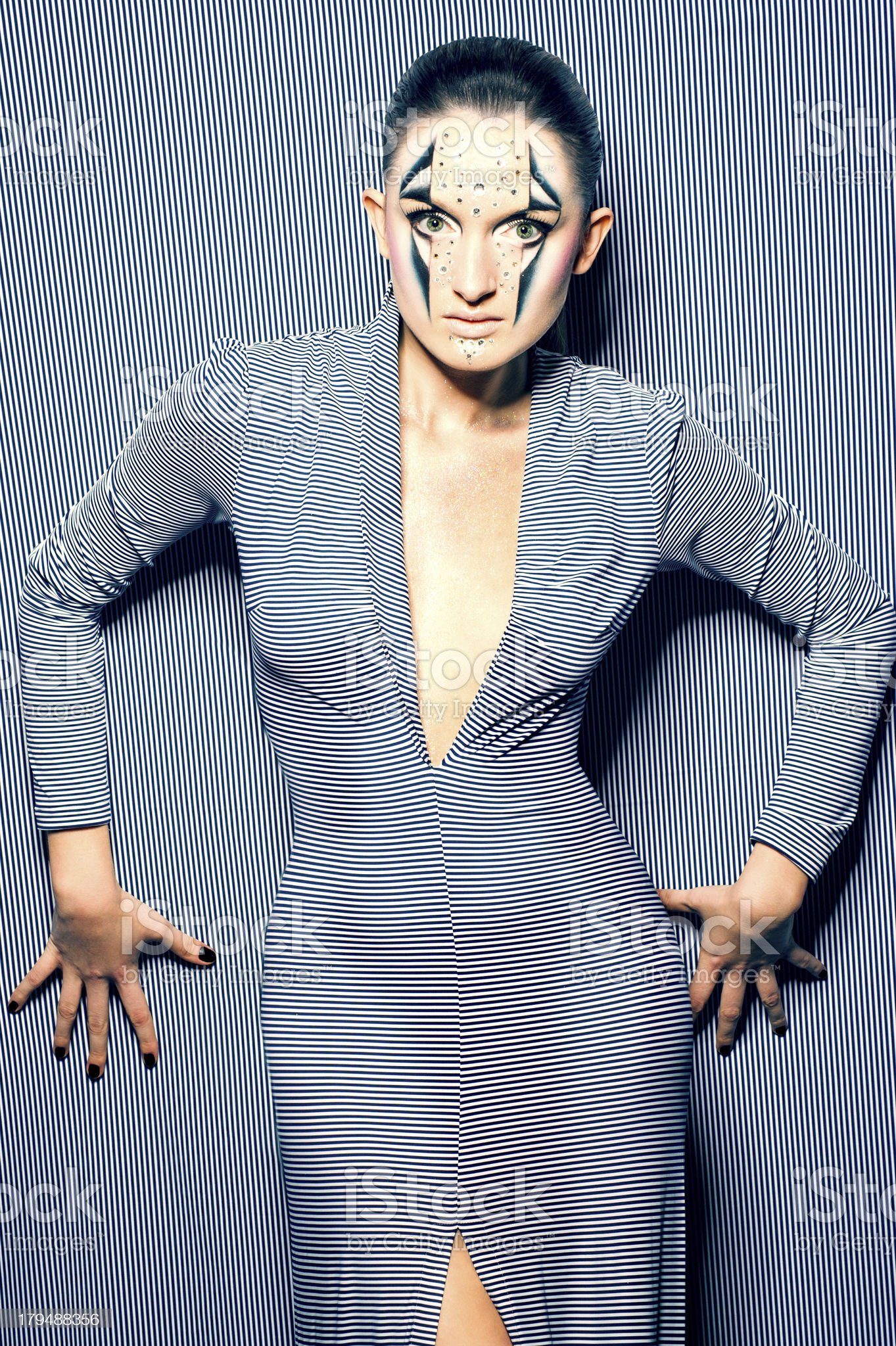 girl in a striped background with psychedelic art make-up royalty-free stock photo