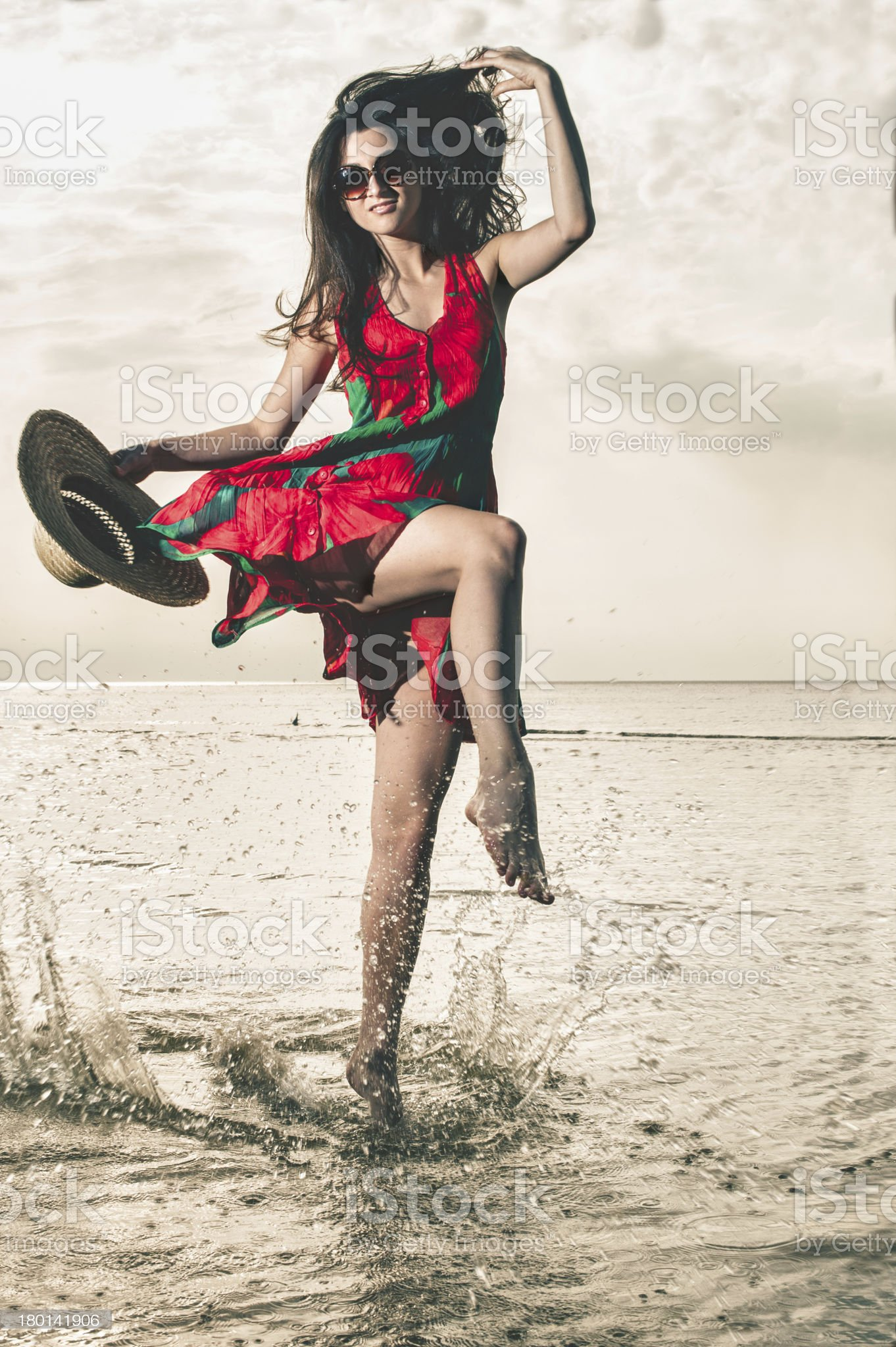 girl in a summer dress  splashes of ocean water royalty-free stock photo